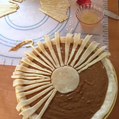 Apple butter pumpkin pie with a sunburst top crust